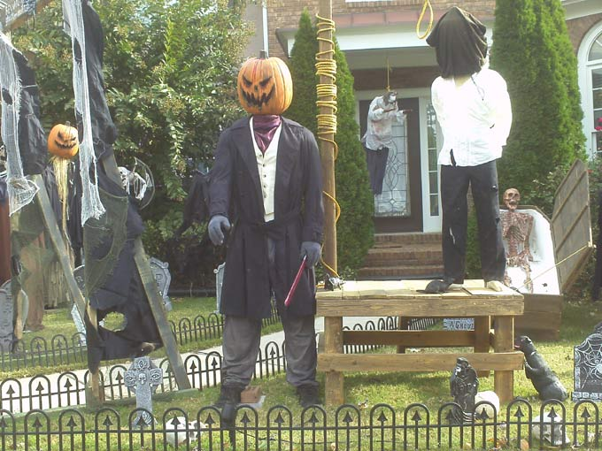 Day View of Gallows, Executioner, Mummy in Coffin with Sleepy Hollow Scarecrow in Background