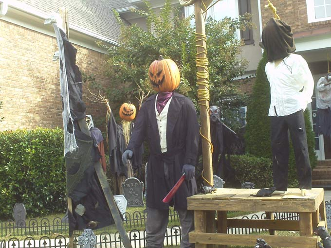 Day View of Gallows, Executioner with Sleepy Hollow Scarecrow in Background
