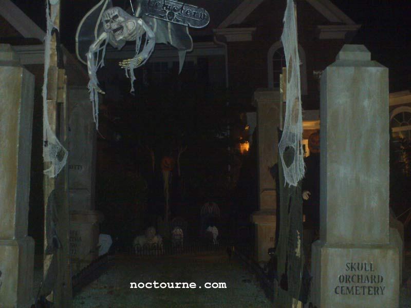 Night View of our Halloween Graveyard Entrance Banner Bat Skeleton Skull Orchard Cemetery