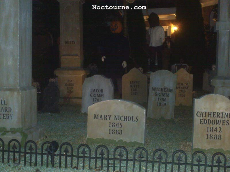 Night View of our Halloween Graveyard Skull Orchard Cemetery with Gallows and Executioner