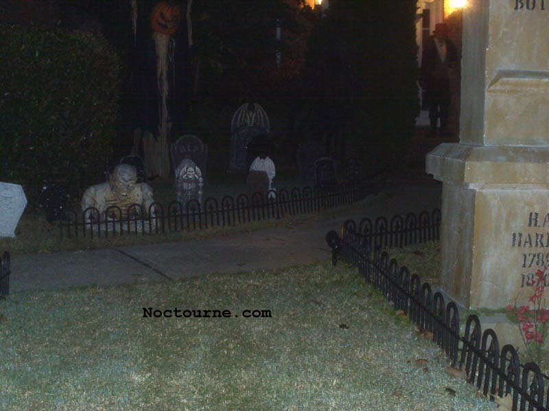 Night View of our Halloween Graveyard Skull Orchard Cemetery with Grave Yard Ghoul and Sleepy Hollow Scarecrow