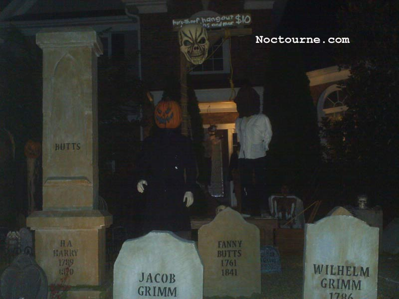 Night View of our Graveyard Skull Orchard Cemetery with Gallows, Executioner and Corpse in Coffin