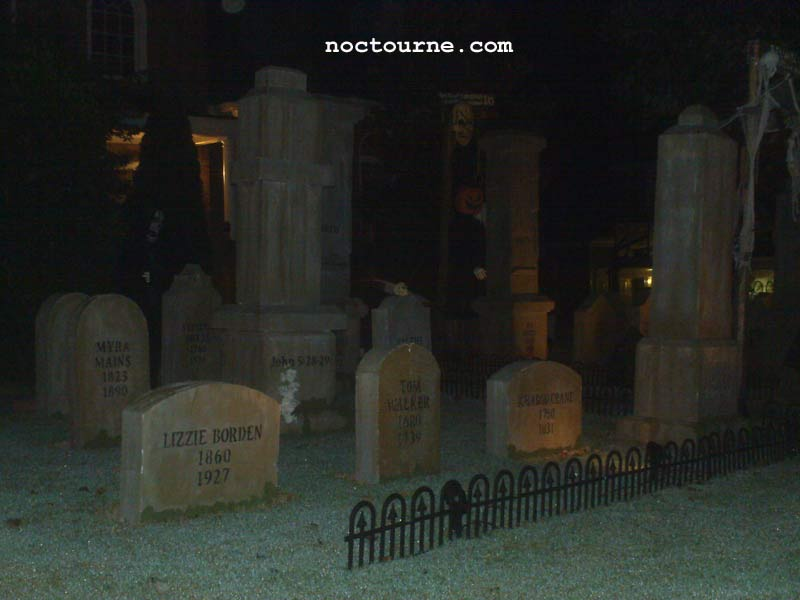 Night View of Halloween Graveyard Skull Orchard Cemetery with Grave Yard Ghoul