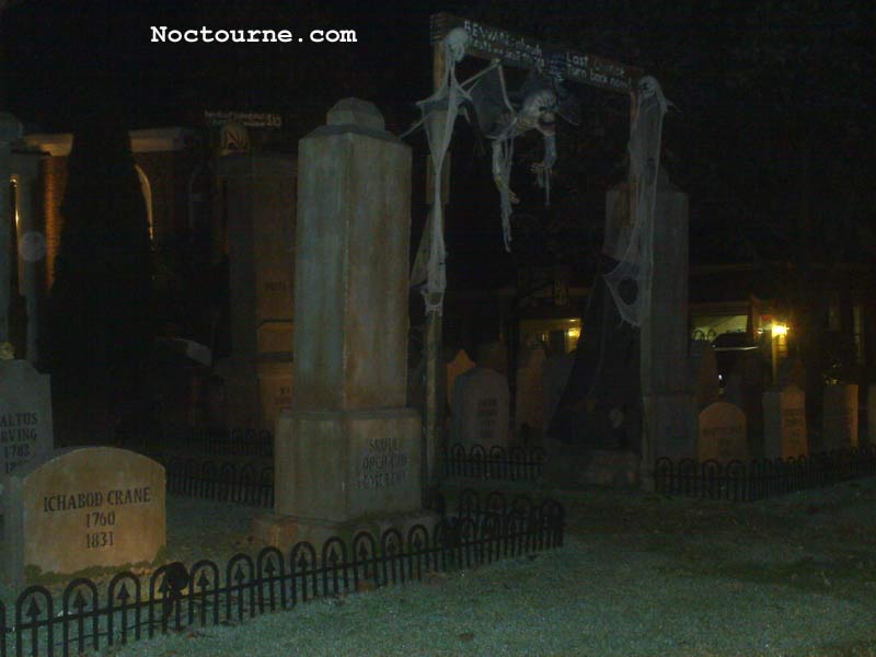 Night View of Halloween Graveyard Entrance Banner Bat Skeleton Skull Orchard Cemetery