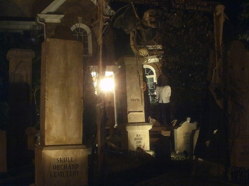 Night View of Halloween Graveyard Entrance Bat Skeleton Skull Orchard Cemetery