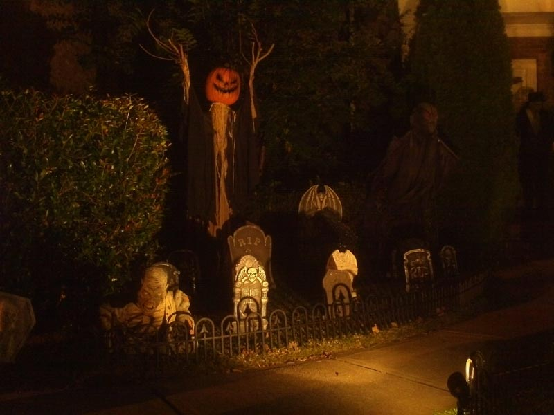 Night View Halloween Graveyard Cemetery with Sleepy Hollow Scarecrow and Black Spectre