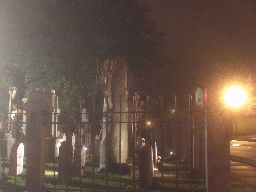 Night View of Halloween Graveyard Cemetery with Crypt Ghoul