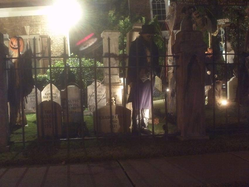 Night View of Front Gate Entrance to Halloween Graveyard Cemetery